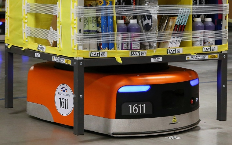 Image:  A Kiva robot moves a rack of merchandise at an Amazon fulfillment center