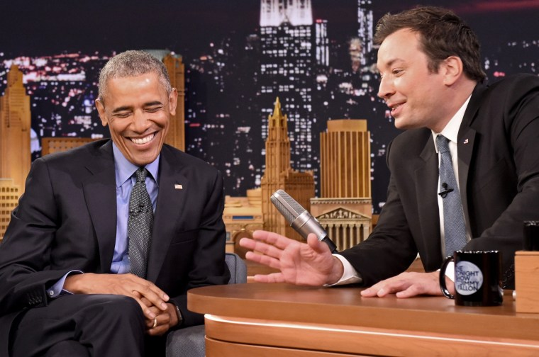Image: President Barack Obama, left, laughs while listening to host Jimmy Fallon