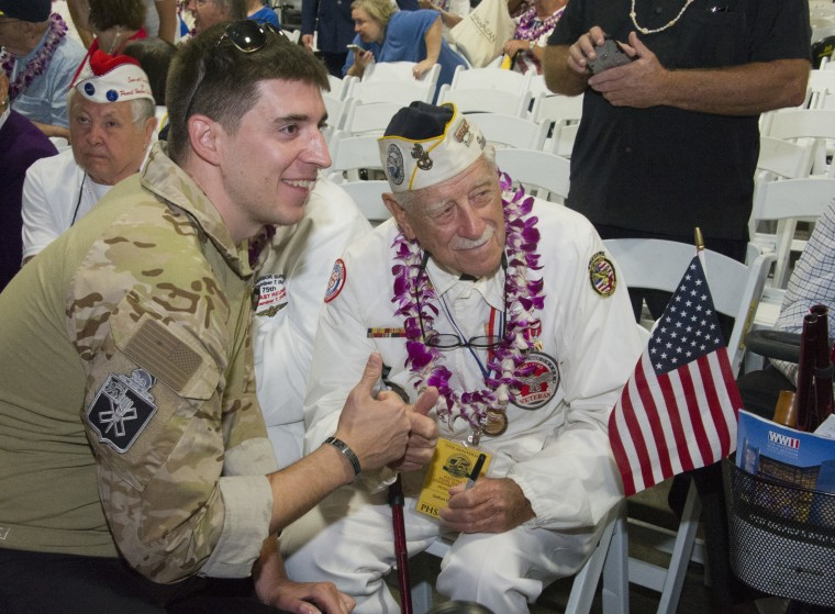 Image: A man poses with a Pearl Harbor survivor