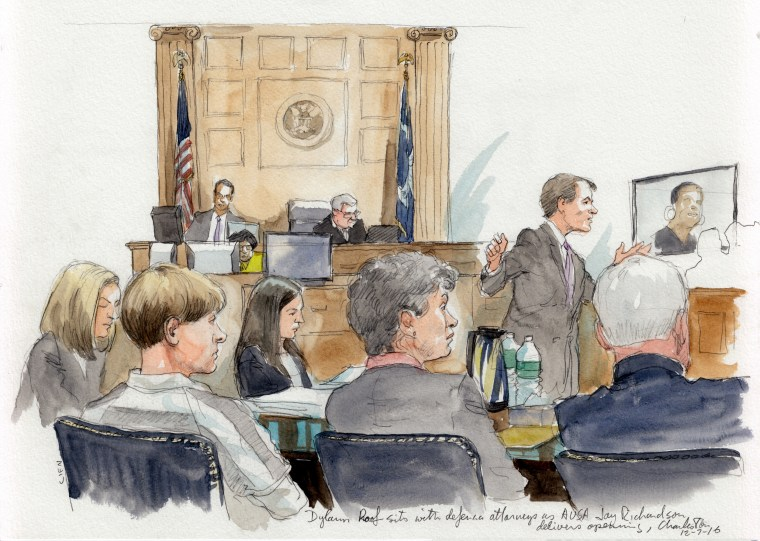 Image: Dylan Roof sits with his defense attorneys as Asst. U.S. Attorney Jay Richardson delivers his opening