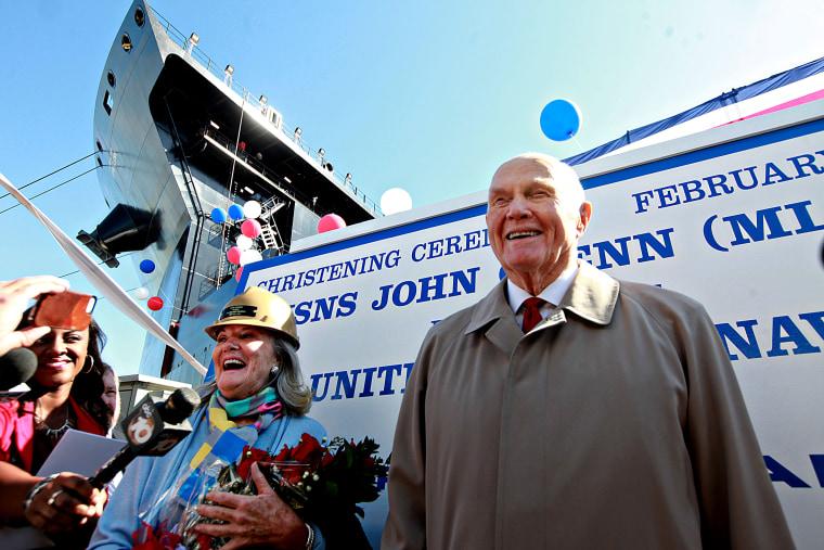 Senator John Glenn speaks with reporters, with his Daughter Lyn Glenn, during the christening ceremony for the USNS John Glenn at the General Dynamics NASSCO Shipyard in San Diego