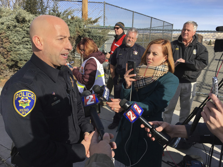 Reno police officer Tim Broadway briefs reporters outside Hug High School on the north side of Reno, Nevada, Dec. 7, 2016 after a Washoe County School District police officer shot a student following a disturbance at the school. The student was taken to a Reno hospital where there was no immediate word on the student's condition.
