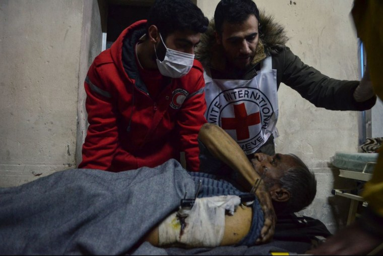 Image: A patient is evacuated from a hospital in the Old City of Aleppo, in a joint operation by the Syrian Arab Red Crescent (SARC)