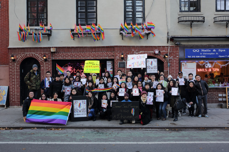 Demonstrators in support of same-sex marriage in Taiwan in front of the Stonewall Inn in New York City.