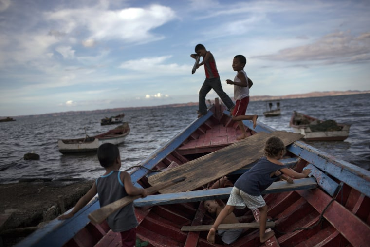 "Image: Children play ""pirates"" on a fishing boat"