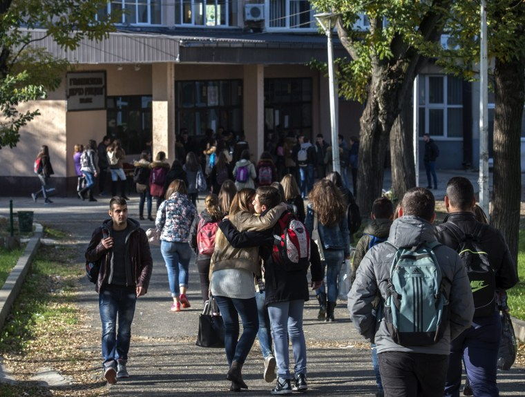 Image: Students arrive in their High school 'Kosta Racin' in the town of Veles