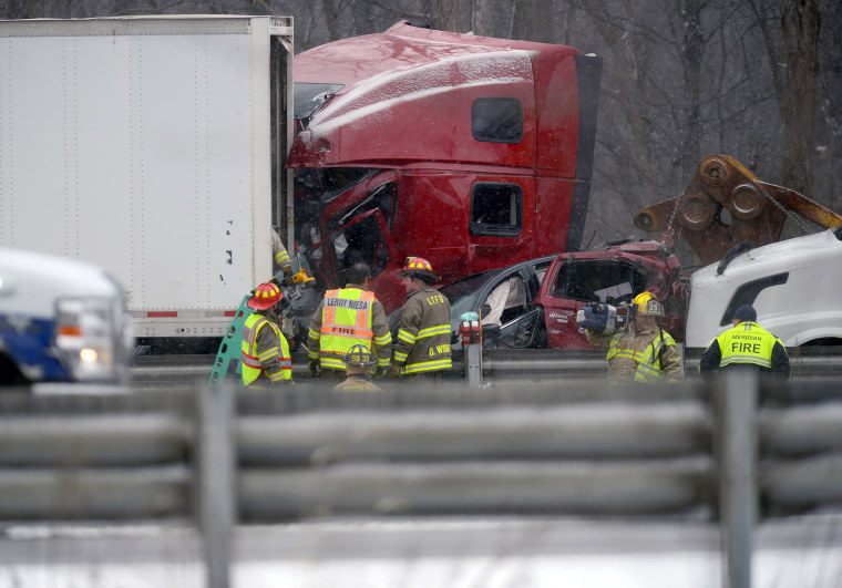 Emergency crews work the scene of a multiple car pileup on I-96 between Webberville and Fowlerville, Michigan, Dec. 8.