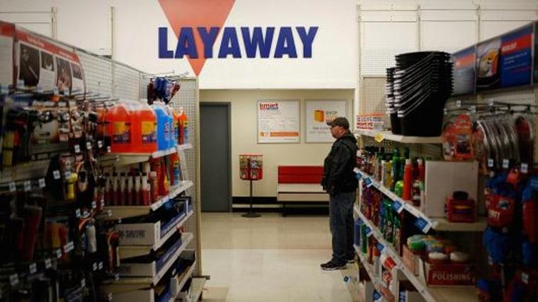 A shopper stands near the layaway counter. Luke Sharrett | Bloomberg | Getty Images