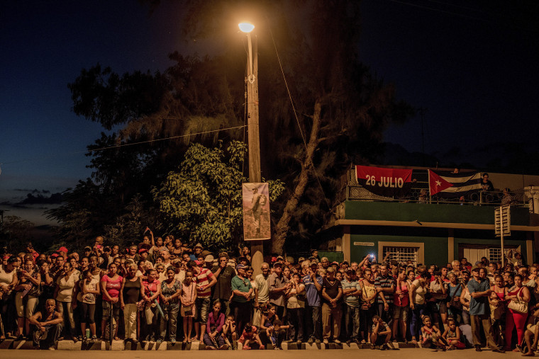 Image: People wait to see the caravan carrying Fidel Castro's ashes in Bayamo, Cuba.