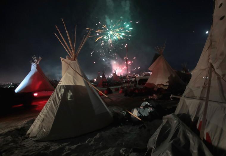 Image: Fireworks fill the night sky above Oceti Sakowin camp
