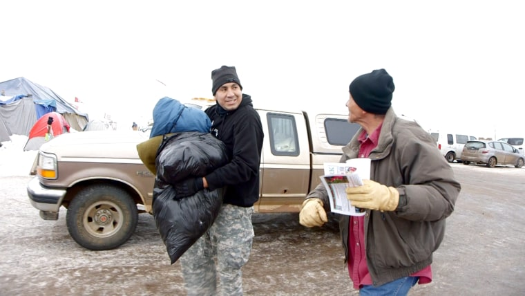 Dustin Monroe carries clothing donations for the Oceti Sakowin camp.