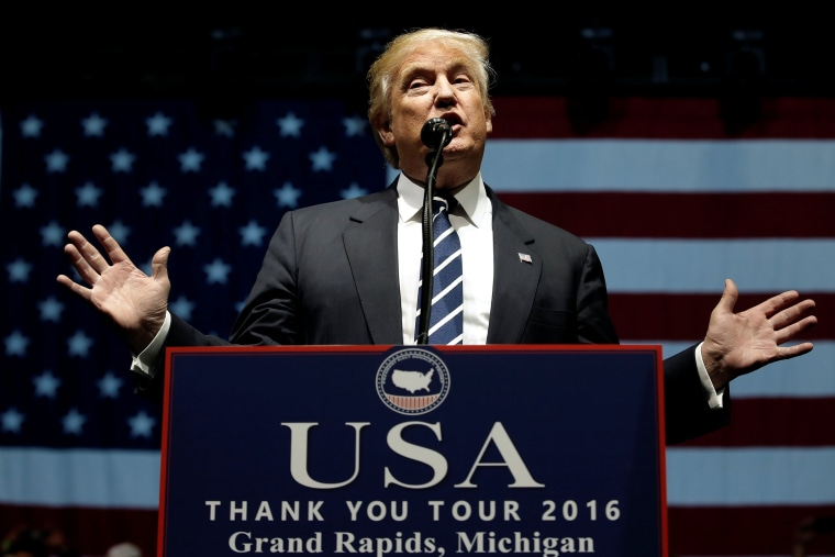 "Image: U.S. President-elect Donald Trump speaks at a ""Thank You USA"" tour rally in Grand Rapids"
