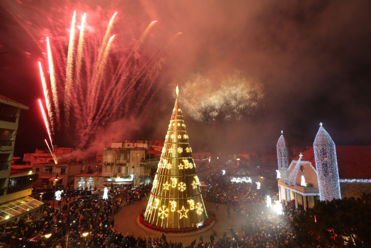 Image: Fireworks are set off as a Christmas tree is illuminated in Dhour Shweir, Mount Lebanon