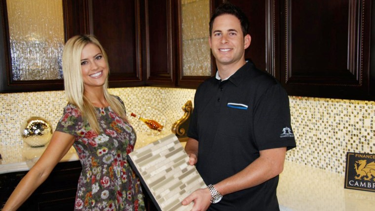 Husband and wife team, Tarek and Christina El Moussa, discuss renovation plans on the set of HGTV's Flip or Flop.