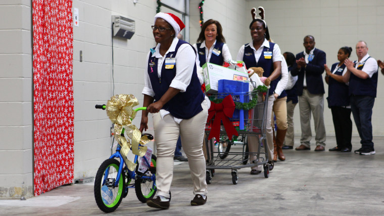 Walmart workers surprise families with gifts