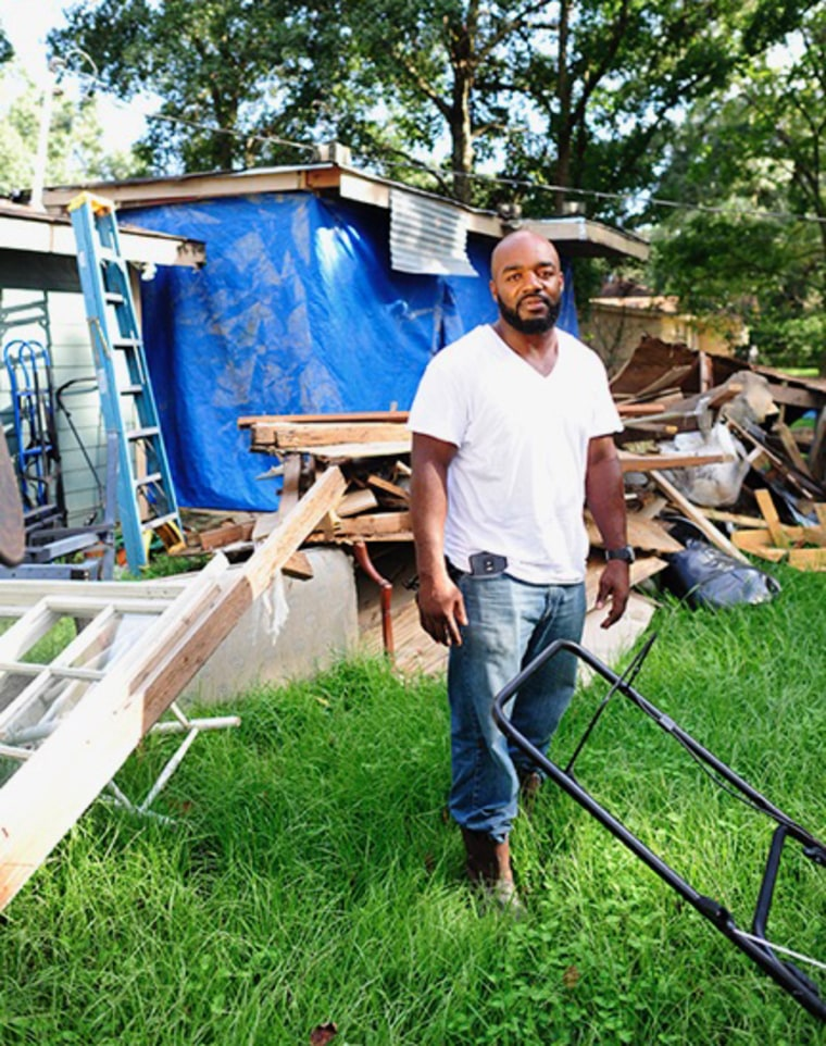 Fred Thomas in front of his home after the Baton Rouge floods in August 2016