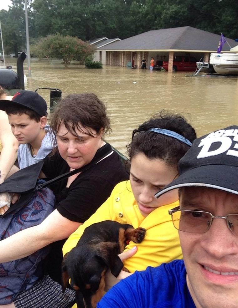 Wendi Nelms and her family evacuating from their home in Baton Rouge after the floods