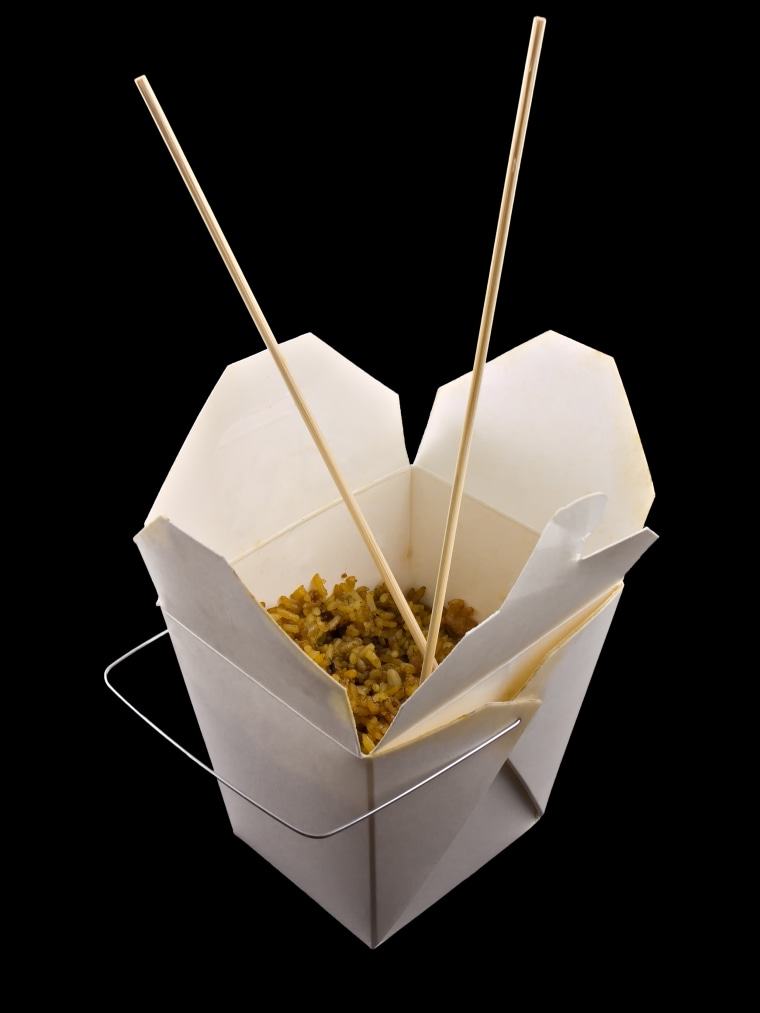 Chinese take out in a Chinese food container.