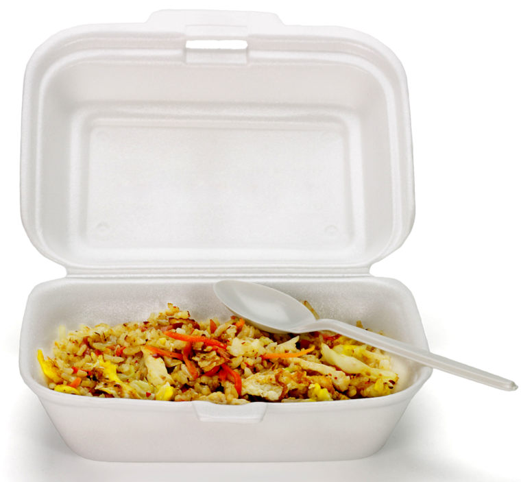 Fried rice in Styrofoam box with plastic disposable spoon