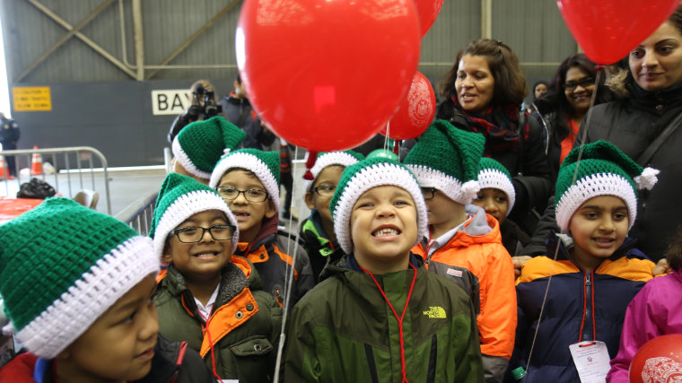 Kids leaving Operation Santa Claus