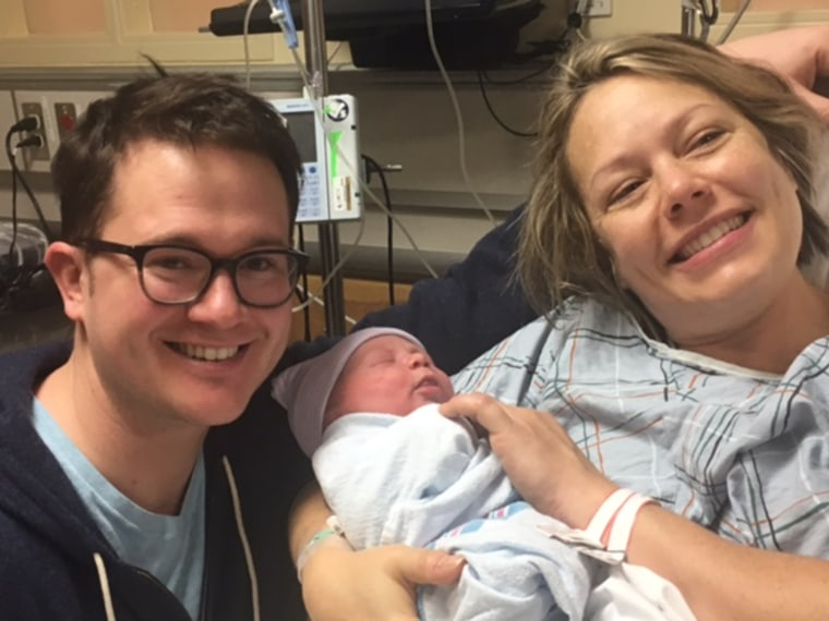 Dylan Dreyer and her husband, Brian Fichera, pose with their bundle of joy shortly after his birth.