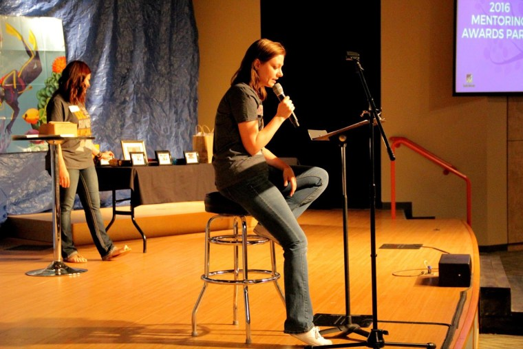 Deena Shoemaker speaking at a Youth Horizons awards party