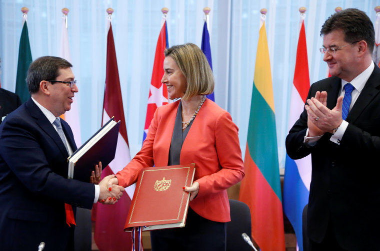 Cuba's Foreign Minister Rodriguez shakes hands with EU foreign policy chief Mogherini