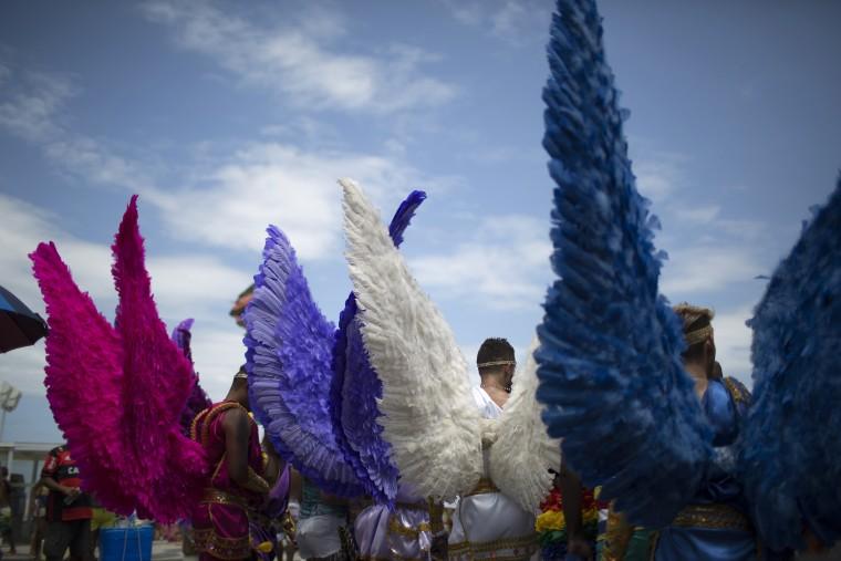 Image: Revelers take part in the 21st Rio LGBT pride parade at Copacabana beach in Rio de Janeiro