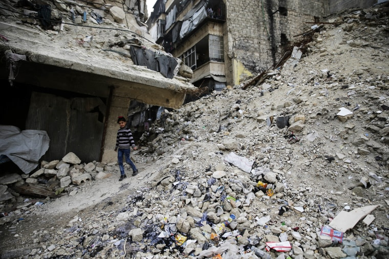 Image: A Syrian girl walks amid the wreckage of damaged buildings and shops in the western city of Aleppo, Syria on Dec. 5.