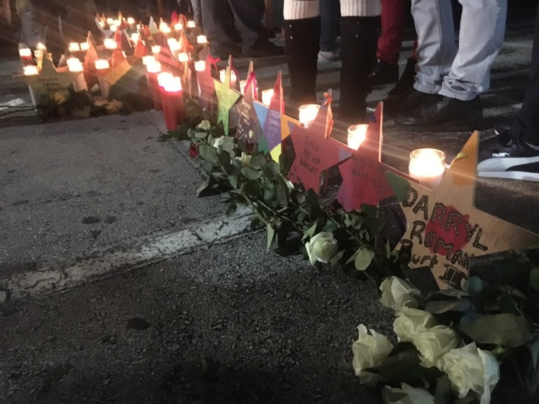Family and friends of victims, and survivors of the Pulse nightclub attack gather at the club at 2:02 a.m., the time when the shooting started, on Monday, Dec. 12, 2016, the six-month anniversary of the tragedy.