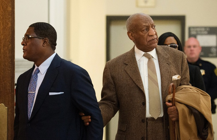 Image: Bill Cosby re-enters Montgomery County Courthouse after a break during the second day of his pre-trial hearing in his sexual assault case in Norristown