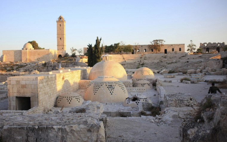 Image: A general view shows damage at Aleppo's historic citadel in 2014