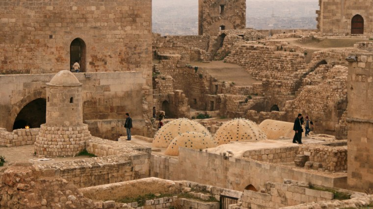Image: People tour inside Aleppo's historic citadel in 2009