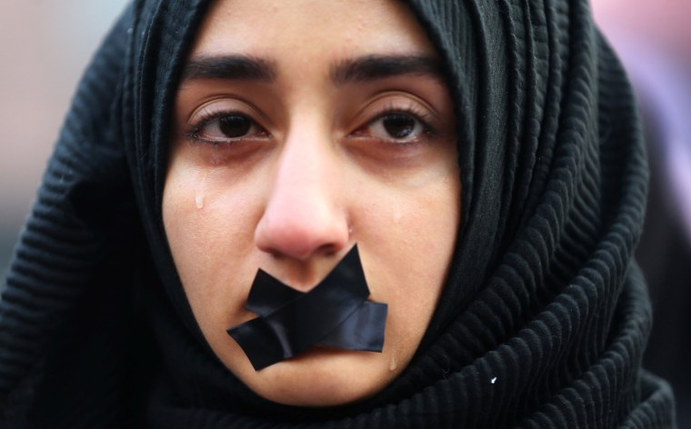 Image: A Turkish student cries during a protest to show solidarity with trapped citizens of Aleppo, Syria, in Sarajevo, Bosnia and Herzegovina