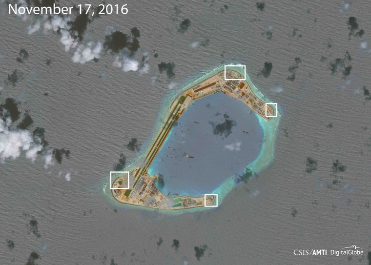 Image: A satellite image shows what CSIS Asia Maritime Transparency Initiative says appears to be anti-aircraft guns and what are likely to be close-in weapons systems (CIWS) on the artificial island Subi Reef in the South China Sea