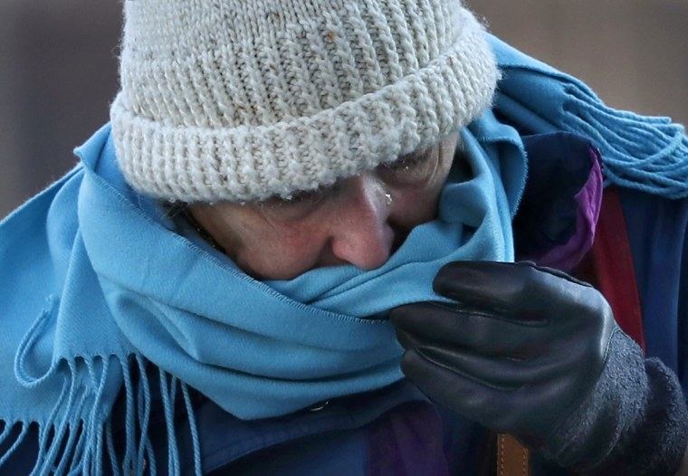 A woman uses her scarf to wipe away a tear brought on by frigid weather, Thursday, Dec. 15, 2016, in Portland, Maine. Much of the northern Mid-Atlantic and Northeast will stay cold for the next couple of days as the arctic air remains stuck over the northern Appalachians, the National Weather Service said.