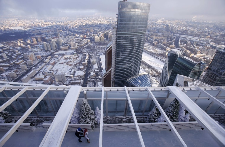 Image: People skate during the opening of an ice rink on the roof of a skyscraper in Moscow