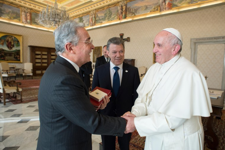 This handout picture released by the Vatican press office shows Colombian president Juan Manuel Santos (C) standing as former president Alvaro Uribe shakes hands with the Pope Francis (R) during a meeting, on January 16, 2016 at the Vatican.   -/AFP/Getty