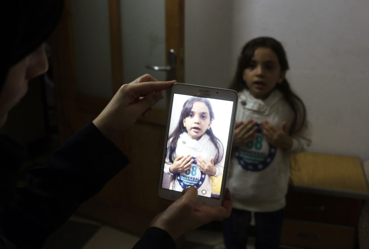 Image: Syrian Bana al-Abed is filmed by her mother as they prepare to post on Twitter in English about life in the besieged eastern districts of Syria's Aleppo, on Oct. 12.