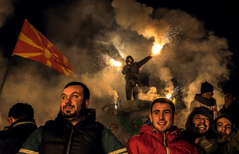 Image: Supporters of the opposition Social Democratic Union of Macedonia (SDSM) party hold flares and wave Macedonian flags during the party's last election rally in Skopje, the former Yugoslav Republic of Macedonia, Dec. 9.