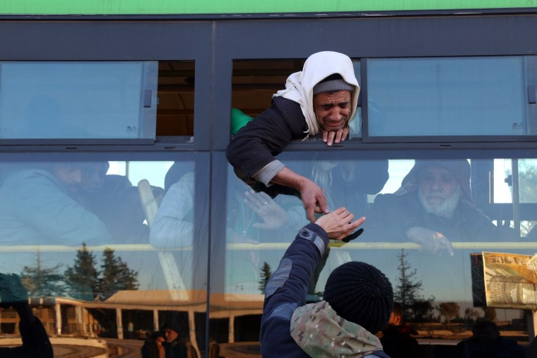 Image: Syrians, who were evacuated from rebel-held neighbourhoods in the embattled city of Aleppo, arrive in the opposition-controlled Khan al-Aassal region