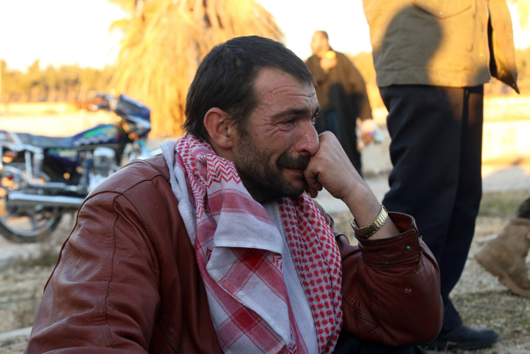 Image: A Syrian man, who was evacuated from rebel-held neighbourhoods in the embattled city of Aleppo, cries upon his arrival in the opposition-controlled Khan al-Aassal region