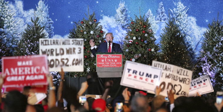 President-elect Donald Trump speaks to cheering supporters in front of a Christmas-themed backdrop at a rally in Orlando, Fla., Friday night, Dec. 16, 2016.
