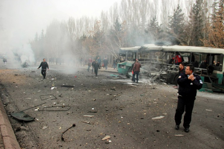 People react after a bus was hit by an explosion in Kayseri