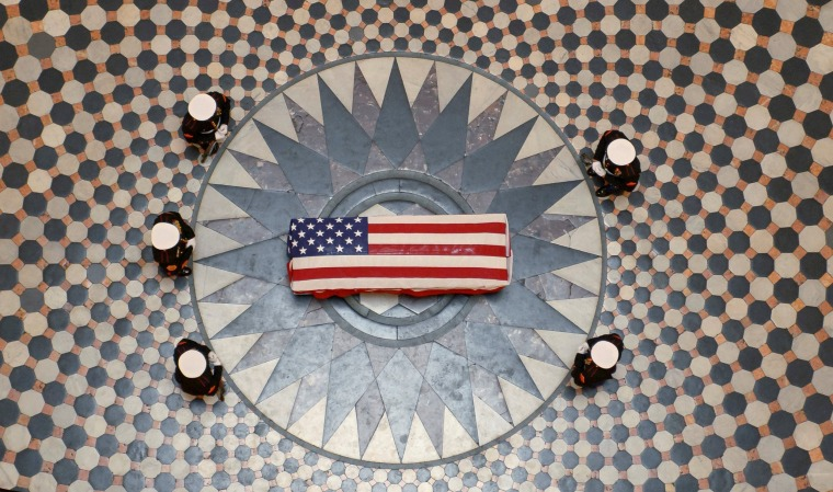 Image: Former astronaut and United States Senator John Glenn lies in state, under a U.S. Marine honor guard, in the Rotunda of the Ohio Statehouse in Columbus, Ohio