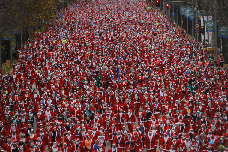 Image: People dressed in Santa Claus costumes take part in a run in Madrid, Dec. 17, 2016.