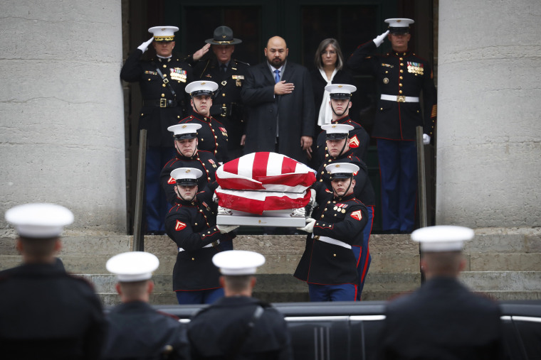 Image: The casket of John Glenn is carried out of the Ohio Statehouse by Marines during his funeral procession, Dec. 17, in Columbus, Ohio.