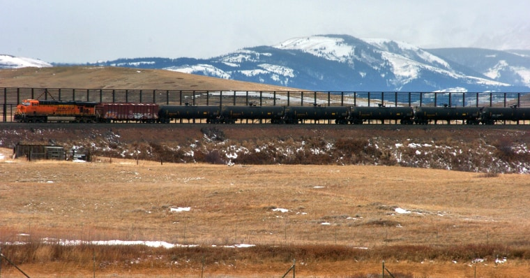 A train hauls oil into Glacier National Park near the Badger-Two Medicine National Forest in northwest Montana.