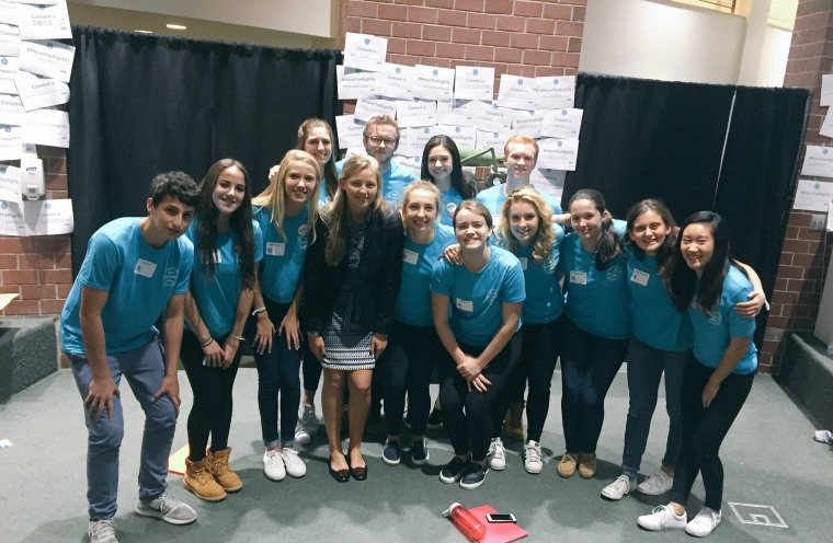 Prout poses with students at Georgetown Day School, which hosted the Washington Area Independent School Summit on Sexual Assault and Consent. Prout spoke at the event, along with other teenage survivors.