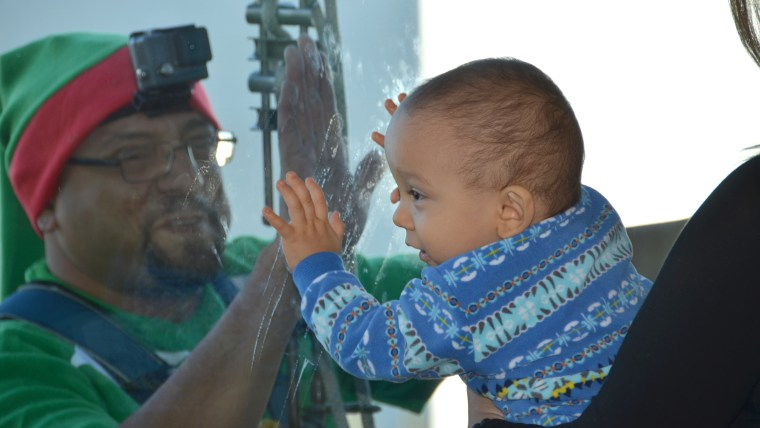 Window-washing Santa, elves surprise patients at Nemours Children's Hospital